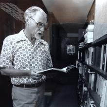 Don searching in book from his shelves