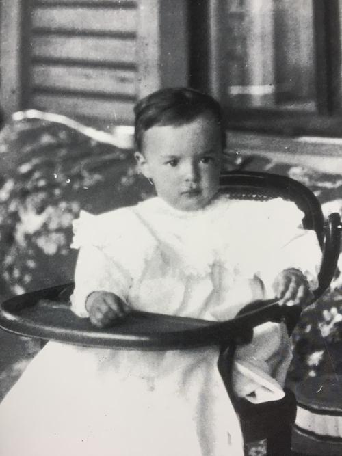 VN in 1901, two years old, on the veranda of the Vyra mansion. © The Vladimir Nabokov Literary Foundation.