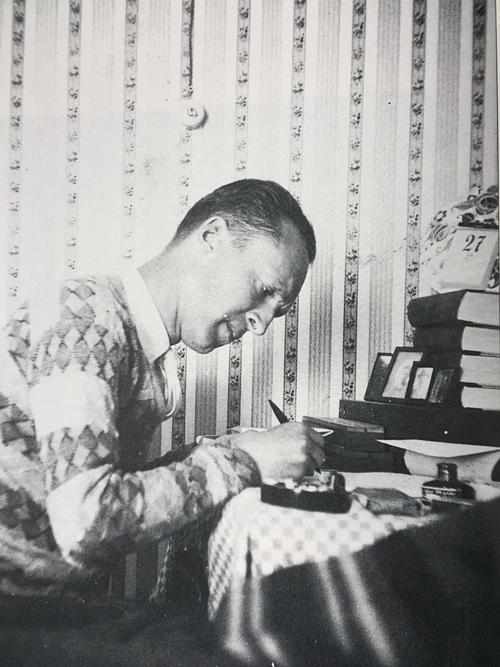 "VN writing, 1929. This picture, taken by VéN, inspired VN to write a lengthy caption for its reproduction in Speak, Memory (opp. page 257): ""Seldom does a casual snapshot compendiate a  life so precisely."" © The Vladimir Nabokov Literary Foundation."